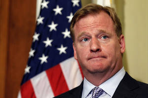 Photo -   NFL Commissioner Roger Goodell stands during a media availability after a meeting with Democratic Whip Sen. Dick Durbin, D-Ill., left, to discuss bounty programs, on Capitol Hill Wednesday, June 20, 2012 in Washington. (AP Photo/Alex Brandon)