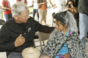 Actor Mark Harmon thanks Leah Gardner, 5, for a pin and a hand-woven basket given to him by the Kenwood School Cherokee Singers during a short ceremony and tour of the Oklahoma City Indian Clinic's future Harmon-y Pediatric Facility in Oklahoma City, Thursday, June 1 2012. Photo By Steve Gooch, The Oklahoman <strong></strong>