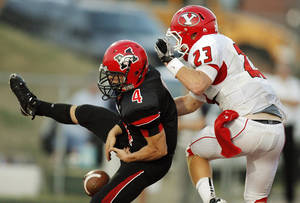 Photo - Mustang's Frankie Edwards (4) drops a pass in the end zone in front of Derek Deeds (23) of Yukon during a high school football game between Yukon and Mustang at Mustang High School in Mustang, Okla., Friday, Sept. 2, 2011. Photo by Nate Billings, The Oklahoman