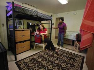 Photo - Allison Henry, a University of Oklahoma junior from Norman, and Harriet Orleans, an OU senior from Tulsa, check out a model suite in Walker Tower at OU. Photo by Steve Sisney, The Oklahoman ORG XMIT: KOD <strong>STEVE SISNEY - THE OKLAHOMAN</strong>