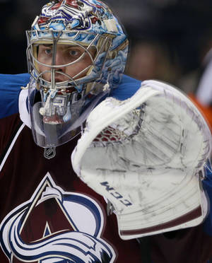 Photo - Colorado Avalanche goalie Semyon Varlamov, of Russia, searches for the puck while protecting the goal against the Dallas Stars in the third period of the Avalanche's 6-2 victory in an NHL hockey game in Denver on Monday, Dec. 16, 2013. (AP Photo/David Zalubowski)