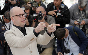 Photo - Director Steven Soderbergh poses for photographers during a photo call for the film Behind the Candelabra  at the 66th international film festival, in Cannes, southern France, Tuesday, May 21, 2013. (AP Photo/Lionel Cironneau)