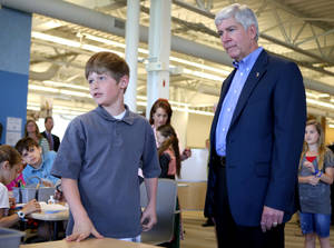 Photo - Michigan Gov. Rick Snyder visits Innocademy Charter School in Zeeland, Mich. Wednesday, May 8, 2013. The event featured an announcement about iCademy, a new public online charter school. (AP Photo/The Sentinel, Robert Mathews)