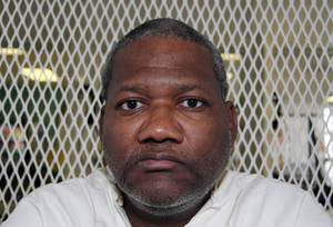 Photo -   In this Oct. 17, 2012, photo, Texas death row inmate Preston Hughes III speaks from a visiting cage at the Texas Department of Criminal Justice Polunsky Unit outside Livingston, Texas. Hughes is scheduled for lethal injection Nov. 15, 2012, for the 1988 murders in Houston of Shandra Charles, 15, and her 3-year-old cousin, Marcell Taylor. (AP Photo/Michael Graczyk)