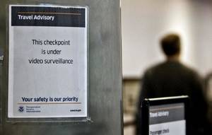 photo - An airline travelers go through the security checkpoint at Will Rogers World Airpot on Monday, Nov. 22, 2010, in Oklahoma City, Okla. Enhanced security measures have been put into place by the Transportation Security Administration to insure safety for holiday travelers.   Photo by Chris Landsberger, The Oklahoman ORG XMIT: KOD <strong>CHRIS LANDSBERGER - CHRIS LANDSBERGER</strong>