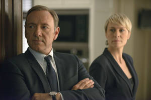 """Photo - FILE - This image released by Netflix shows Kevin Spacey as Francis Underwood, left, and Robin Wright as Clair Underwood in a scene from """"House of Cards."""" Netflix reports quarterly earnings on Monday, April 21, 2014. (AP Photo/Netflix, Nathaniel E. Bell, File)"""