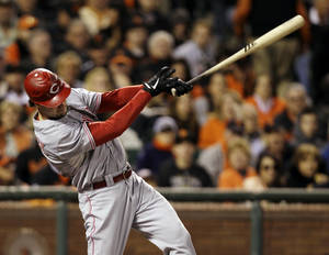 Photo -   Cincinnati Reds' Ryan Ludwick hits a solo home run in the second inning during Game 2 of the National League division baseball series against the San Francisco Giants in San Francisco, Sunday, Oct. 7, 2012. (AP Photo/Eric Risberg)