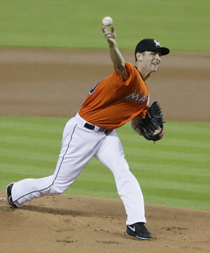 Photo - Miami Marlins' Jacob Turner delivers a pitch during the first inning of a baseball game against the Washington Nationals, Sunday, Sept. 8, 2013, in Miami. (AP Photo/Wilfredo Lee)