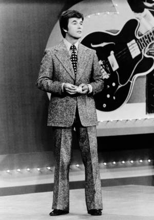 "Photo -   FILE - In this 1973 file photo released by ABC, Dick Clark presents the Rock and Roll Year_ a musical portrait of the 1950s and 1960s on the ABC television network in a series of five specials. Clark, the television host who helped bring rock `n' roll into the mainstream on ""American Bandstand,"" died Wednesday, April 18, 2012 of a heart attack. He was 82. (AP Photo/ABC, File)"