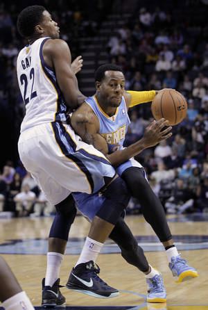 Photo -   Denver Nuggets' Andre Iguodala, right, is guarded by Memphis Grizzlies' Rudy Gay (22) during the first half of an NBA basketball game in Memphis, Tenn., Monday, Nov. 19, 2012. (AP Photo/Danny Johnston)