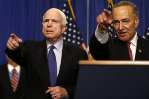 Photo - Sen. John McCain, R-Ariz., left, and Sen. Charles Schumer, D-N.Y. take questions during a news conference on immigration reform legislation, Thursday, April 18, 2013, on Capitol Hill in Washington. (AP Photo/Charles Dharapak)