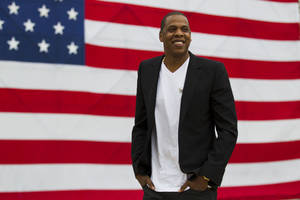 "Photo - Entertainer Shawn ""Jay-Z"" Carter smiles Monday in between interviews, after a news conference at Philadelphia Museum of Art. The rapper announced plans for a two-day music festival in Philadelphia's at Fairmount Park on Labor Day weekend. AP PHOTO"