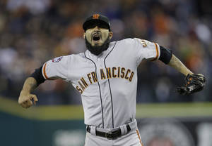 Photo -   San Francisco Giants' Sergio Romo reacts after striking out Detroit Tigers' Omar Infante to end Game 3 of baseball's World Series Saturday, Oct. 27, 2012, in Detroit. The Giants defeated the Tigers 2-0. The Giants lead the series 3-0. (AP Photo/Matt Slocum)