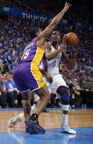 photo - Oklahoma City's Kevin Durant (35) looks to shoots as Los Angeles' Metta World Peace (15) defends during Game 1 in the second round of the NBA playoffs between the Oklahoma City Thunder and the L.A. Lakers at Chesapeake Energy Arena in Oklahoma City, Monday, May 14, 2012. Photo by Sarah Phipps, The Oklahoman