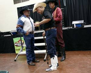 Photo - Steve Womack (left) talks with James Barnett (center) of Sherman, Tx., after Cowboy Church at the Oklahoma State Fair at State Fair Park in Oklahoma City on Sunday, September 18, 2011. Photo by John Clanton, The Oklahoman ORG XMIT: KOD