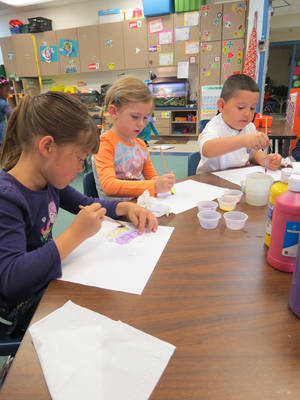 Photo - Students at Orvis Risner Elementary School work in class. The school will celebrate its 50th anniversary on Saturday. PHOTO PROVIDED BY  EDMOND PUBLIC SCHOOLS <strong>EDMOND PUBLIC SCHOOL DISTRICT - PHOTO PROVIDED</strong>