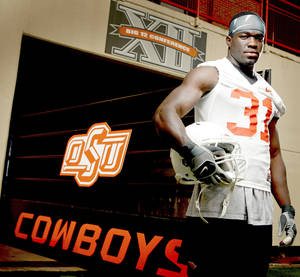 Photo - OSU defensive back Lucien Antoine moved to the United State from Haiti when he was 16.  Photo by Bryan Terry, The Oklahoman