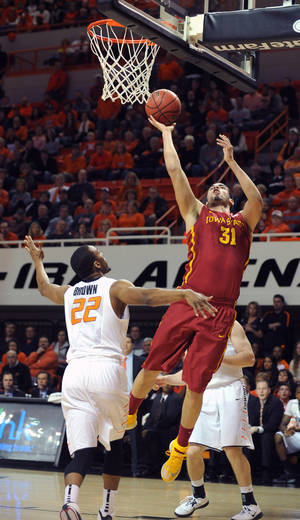 Photo - Iowa State's Georges Niang (31) takes a shot over Oklahoma State's Markel Brown (22) during the first half of an NCAA college basketball game in Stillwater, Okla., Monday, Feb. 3, 2014. (AP Photo/Brody Schmidt)
