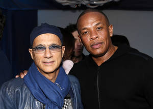 Photo - FILE - This Feb. 10, 2013 file photo shows music industry entrepreneur Jimmy Iovine, left, and hip-hop mogul Dr. Dre at a Grammy Party in Los Angeles. It's as if anything Iovine and Dre touches turns to gold: The dynamic duo marked epic-level success when they introduced Eminem to the music world 15 years ago, and their lucrative Beats by Dre business reached blockbuster heights following reports on Thursday, May 8, 2014, that Apple plans to by the headphone's parent company, Beats Electronics, for $3.2 billion.  (Photo by Todd Williamson/Invision/AP, file)