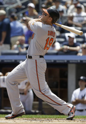 Photo - Baltimore Orioles' Chris Davis follows through on a two-run home run during the first inning of a baseball game against the New York Yankees on Saturday, July 6, 2013, in New York. (AP Photo/Frank Franklin II)