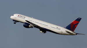 Photo - A Delta Airlines Boeing 757 takes off in Tampa, Fla. Delta Air Lines is making changes to its frequent flier program to reward those who buy its priciest tickets .     AP File Photo <strong>Chris O'Meara - AP</strong>