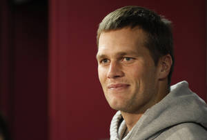 Photo -   New England Patriots quarterback Tom Brady listens to a reporter's question during a media availability at the NFL football team's facility in Foxborough, Mass., Wednesday, Oct. 17, 2012. (AP Photo/Stephan Savoia)