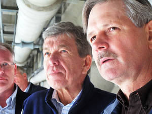 Photo - North Dakota Sen. John Hoeven, right, and Missouri Sen. Roy Blunt tour the Garrison Dam spillway on the Missouri River in Bismarck, N.D. in May.
