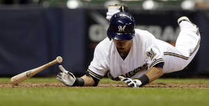 Photo - Milwaukee Brewers' Norichika Aoki hits the ground trying to get away from a pitch from St. Louis Cardinals' Tyler Lyons during the eighth inning of a baseball game Tuesday, Aug. 20, 2013, in Milwaukee. (AP Photo/Morry Gash)