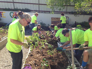 Photo -  Oklahoma County Master Gardeners help children in the Urban Mission after-school program grow vegetables in their own garden spaces. Photo provided  <strong></strong>
