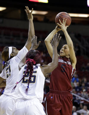 Photo - Washington State's Tia Presley, right, puts up a shot in front of California's Gennifer Brandon (25) and Reshanda Gray in the first half of an NCAA college basketball game in the Pac-12 women's tournament  Friday, March 7, 2014, in Seattle. (AP Photo/Elaine Thompson)