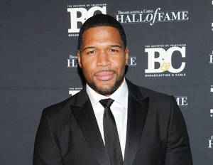 "Photo - FILE - This Oct. 28, 2013 file photo shows former professional football player Michael Strahan, co-host of ""Live with Kelly and Michael,"" attending the 23rd Annual Broadcasting & Cable Hall of Fame Awards in New York. Strahan has made good on reports that he is joining ""Good Morning America"" by paying a visit to the ABC breakfast show on Tuesday, April 15, 2014. The former football star and current co-host with Kelly Ripa of ""Live With Kelly and Michael"" will join ""Good Morning America"" part-time. (Photo by Evan Agostini/Invision/AP, File)"