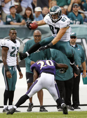 Photo -   FILE - This Sept. 16, 2012 file photo shows Philadelphia Eagles' Brent Celek, top, hurdling Baltimore Ravens' Ed Reed to avoid a tackle in the second half of an NFL football game in Philadelphia. Celek punctuated his career-best receiving day with the hurdle over Reed that made all the highlight reels. Now the underrated tight end may not go unnoticed anymore. (AP Photo/Mel Evans, File)