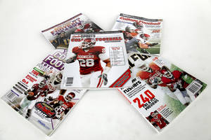 Photo - College football preview guides. PHOTO BY DOUG HOKE, THE OKLAHOMAN
