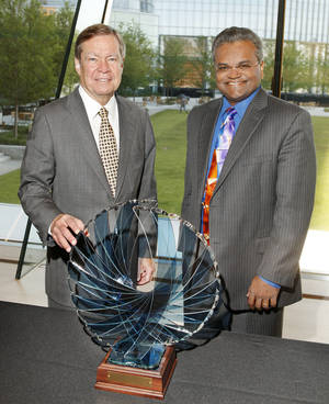 Photo - Larry Nichols, Devon Energy executive chairman, and Mathy Stanislaus, EPA assistant administrator of the Office of Solid Waste and Emergency Response, are shown Friday with the Phoenix Award presented to Devon Energy in Oklahoma City. Photo by Paul B. Southerland, The Oklahoman <strong>PAUL B. SOUTHERLAND</strong>