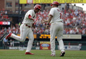 Photo - St. Louis Cardinals' Oscar Taveras, left, is congratulated by third base coach Jose Oquendo after hitting a solo home run during the fifth inning of a baseball game Saturday, May 31, 2014, in St. Louis. (AP Photo/Jeff Roberson)