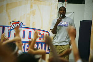 photo - OKLAHOMA CITY THUNDER NBA BASKETBALL PLAYER / CHILD / CHILDREN / KIDS: Serge Ibaka answers questions for kids at the Thunder Youth Basketball Camp at the Santa Fe Family Life Center on Tuesday, June 14, 2011. Photo by Zach Gray, The Oklahoman ORG XMIT: KOD