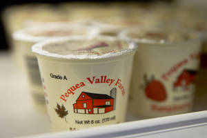 Photo - Pequea Valley Farm yogurts are set out for sale Tuesday, June 24, 2014, at Jefferson University Hospital's cafeteria in Philadelphia. Locally grown foods aren't just for farmers markets anymore. A growing network of companies and organizations is delivering food directly from local farms to institutions like hospitals and schools, eliminating middlemen from farm to fork. They're increasing profits for smaller farms and bringing consumers healthier foods. (AP Photo/Matt Rourke)