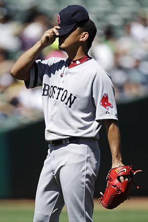 Photo -   Boston Red Sox's Daisuke Matsuzaka, of Japan, adjusts his cap in the second inning of a baseball game against the Oakland Athletics, Sunday, Sept. 2, 2012, in Oakland, Calif. (AP Photo/Ben Margot)