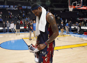 Photo - Cleveland's LeBron James signs his shows following the NBA game between the Oklahoma City Thunder and the Cleveland Cavaliers, Sunday, Dec. 13, 2009, at the Ford Center in Oklahoma City. Photo by Sarah Phipps, The Oklahoman