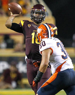 Photo -   Arizona State quarterback Michael Eubank (18) throws over Illinois linebacker Houston Bates (30) during the first half of an NCAA college football game, Saturday, Sept. 8, 2012,in Tempe, Ariz. (AP Photo/Matt York)