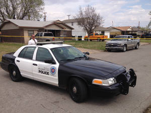 Photo -  Oklahoma City police respond to the scene of a homicide Monday afternoon. Photo by Steve Gooch, The Oklahoman      <strong>   -   </strong>