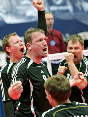 Photo - German players Christoph Herzog, Jurgen Schrapp and Benjamin Oesch (from left to right) celebrate a point against Russia during the fourth day of competition at the World Sitting Volleyball championships on the University of Central Oklahoma campus in Edmond, Okla., on Wednesday, July 14, 2010. Photo by John Clanton, The Oklahoman