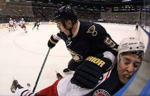 Photo - St. Louis Blues defenseman Barret Jackman slams Columbus Blue Jackets right wing Cam Atkinson against the boards during the first period of an NHL hockey game Saturday, Jan. 4, 2014, in St. Louis. (AP Photo/St. Louis Post-Dispatch, Chris Lee) EDWARDSVILLE OUT  ALTON OUT