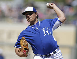 Photo - Kansas City Royals starting pitcher Jason Vargas throws during the third inning of a spring exhibition baseball game against the Texas Rangers, Saturday, March 22, 2014, in Surprise, Ariz. (AP Photo/Darron Cummings)