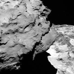 Photo - Close-up detail of comet 67P/Churyumov-Gerasimenko. The image was taken by Rosetta's OSIRIS narrow-angle camera and downloaded Wednesday, Aug. 6, 2014. The image shows the comet's 'head' at the left of the frame, which is casting shadow onto the 'neck' and 'body' to the right. The image was taken from a distance of 120 km and the image resolution is 2.2 meters per pixel. A mission to land the first space probe on a comet reaches a major milestone when the unmanned Rosetta spacecraft finally catches up with its quarry on Wednesday. It's a hotly anticipated rendezvous: Rosetta flew into space more than a decade ago and had to perform a series of complex maneuvers to gain enough speed to chase down the comet on its orbit around the sun. (AP Photo/ESA/Rosetta/MPS for OSIRIS Team )