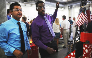 Photo - Desmond Alexander, 17, of Houston, and Angel Prado, 18, of Oklahoma City, watch as their machine hammers a nail. Photo by K.T. KING, The Oklahoman <strong>KT King</strong>