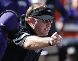 Photo - TCU head coach Gary Patterson talks to his team on the sidelines in the fourth quarter of an NCAA college football game against Oklahoma State in Stillwater, Okla., Saturday, Oct. 19, 2013. Oklahoma State won 24-10. (AP Photo/Sue Ogrocki)