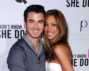 "Photo -   FILE - This Sept. 12, 2011 file photo shows Singer Kevin Jonas, left, and his wife Danielle Deleasa attend the Cinema Society premiere of ""I Don't Know How She Does It"", in New York. The couple star in a new reality show, ""Married to Jonas,"" produced by Ryan Seacrest Productions. It premieres Sunday, Aug. 19 at 10 p.m. EST on E!. (AP Photo/Peter Kramer, file)"