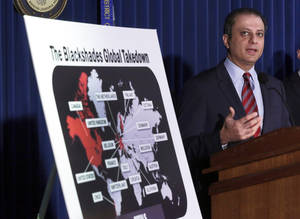 Photo - Preet Bharara, U.S. Attorney for the Southern District of New York, discusses arrests in the malware BlackShades Remote Access Too, during a news conferencel in New York, Monday, May 19, 2014. More than a half million computers in over 100 countries were infected by sophisticated malware that lets cybercriminals take over a computer and hijack its webcam, authorities said as charges were announced Monday against more than 100 people worldwide. (AP Photo/Richard Drew)