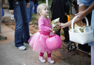 Photo - Callie Gulikers, 2, of Oklahoma CIty gets a treat during Haunt The Zoo in Oklahoma City, Tuesday, October 26, 2010.  Photo by Bryan Terry, The Oklahoman